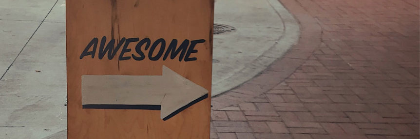 "sidewalk sign saying ""awesome"""
